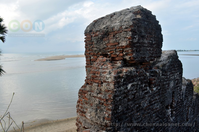 A tall brick wall facing the beach at Alamparai Fort in ECR Road.