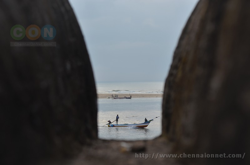 Fishermen on their fishing boat seen returning from the sea. This picture was clicked through the outer walls at Alamparai Fort in ECR Road.