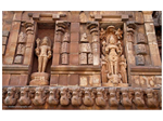 "On the left is a statue of ""Harihara"" or another form of Shiva. Also known as ""Shakaranarayana"" ""Shankar"" - Shiva and ""Narayana"" - Vishnu. On the right is Vishnu Durga. Vishnu Durga, also known as Narayani, is one among the numerous forms of Goddess Durga. Vishnu-Durga is regarded as the sister of Lord Krishna, born immediately before him.She is depicted as standing on head of the buffalo(Mahishasura) killed by Durga."
